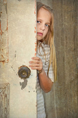 Girl by old door
