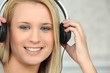 Young woman listening to headphones