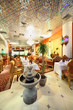 eastern interior of beautiful restaurant, potted palms