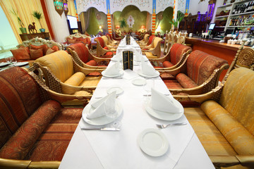 long table with tablecloth and serving in eastern restaurant