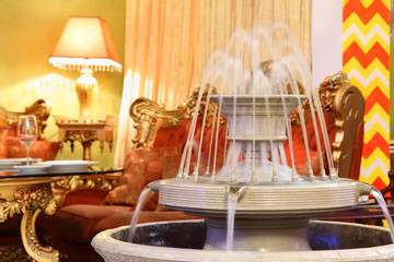 beautiful fountain in eastern luxury restaurant;
