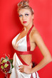beautiful young bride wearing in white dress with red ribbons