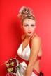 beautiful young bride wearing in original dress witn bouquet