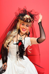 laughing bride wearing black net gloves and unusual hat