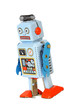 Blue retro mechanical robot toy walks isolated on white