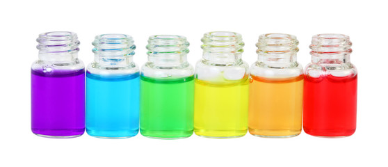Row of six small bottles of different colored aromatic oils