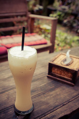 Iced coffee and Bamboo tissue box in the cafe garden