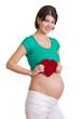 Schwangere Frau mit Herz in der Hand