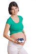 Babyschuhe mit schwangerer Frau