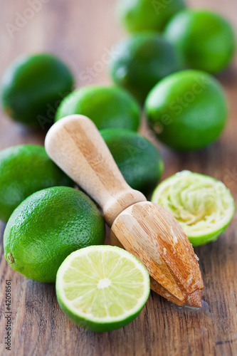 Squeezer and fresh limes