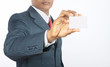 indian business man holding a business card