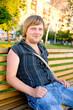 handsome blond man in a park