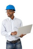Architect in hardhat with laptop