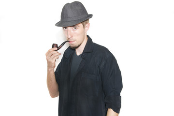 Man in black shirt with tobacco pipe looks into the eyes