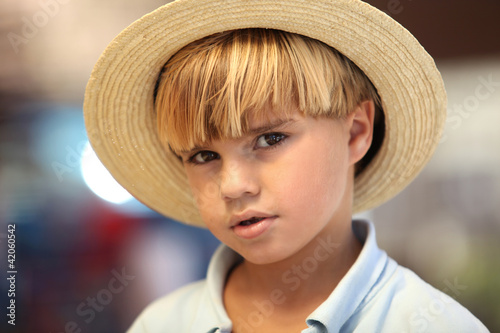 Blond boy with straw hat
