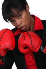 A black businesswoman with boxing gloves.