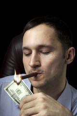 man lighting his cigar