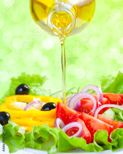 Healthy lifestyle. Fresh salad with oil. Food still life.