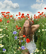 Angel on vacation in a field with spring flowers