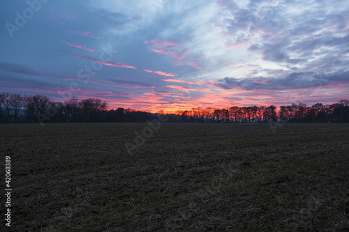 dramatic sunset over a field on a Czech farm