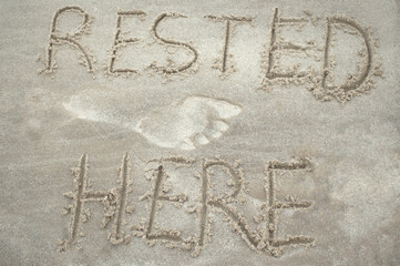 "Inscription ""Rested here"" on the sand"