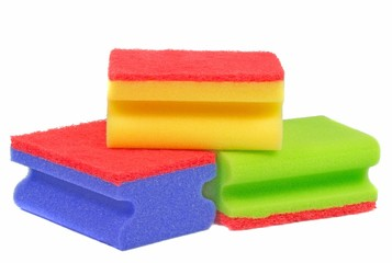 A selection of dish washing sponges on white background