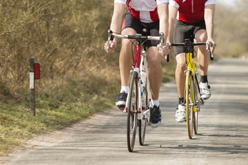 Male Athletes Riding Bicycles