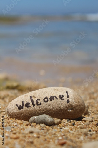 Welcome! - Written on a rock, at the beach