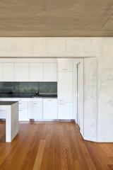 modern concrete house with hardwood floor, detail kitchen