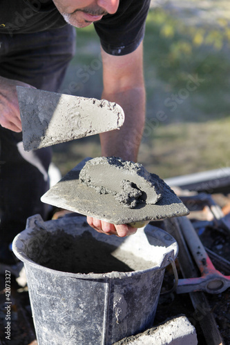 Man with cement and trowel