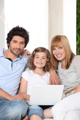 Family with a laptop