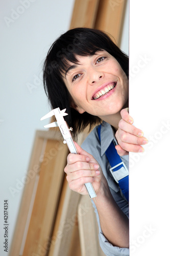 Woman holding calipers