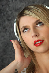 Woman with audio headphones