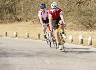Cyclists Riding On A Country Road