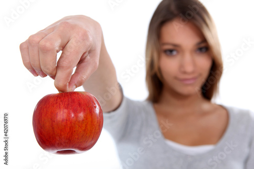 Brunette holding red apple