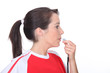 Woman blowing a whistle
