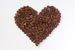 Roasted coffee beans in the shape of a heart