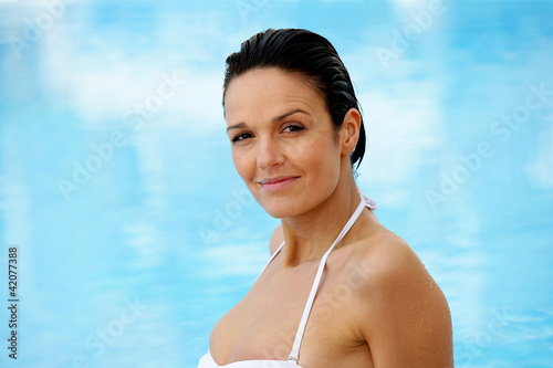 Beautiful woman in a swimming-pool