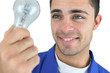 young blue collar holding bulb