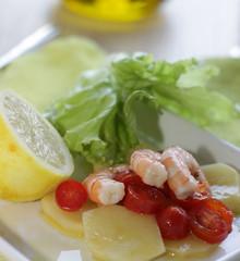 Prawns with potato and tomato