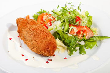 garlic chicken kiev with mixed leaf salad
