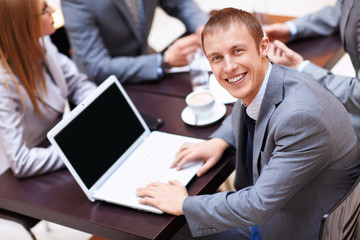 Man in a business suit with a laptop
