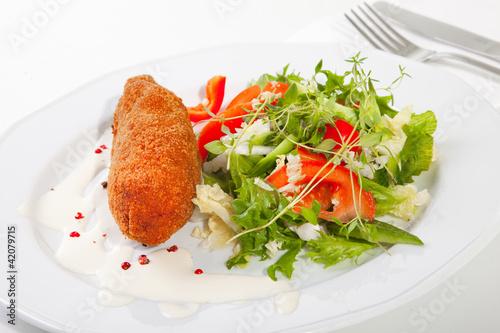 garlic chicken kiev with mixed leaf salad