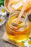 Fototapety Glass honey pot and comb