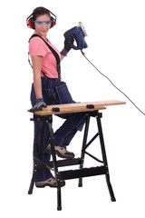 Female carpenter with chainsaw