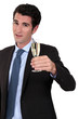 high-spirited businessman drinking a toast