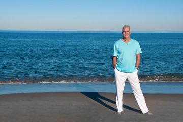 Relaxed mature man at the beach