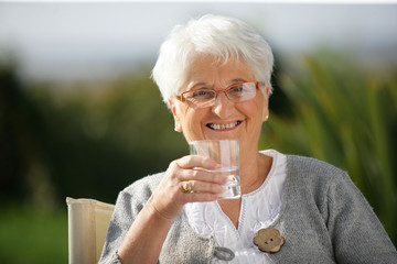 Senior woman with a glass of water