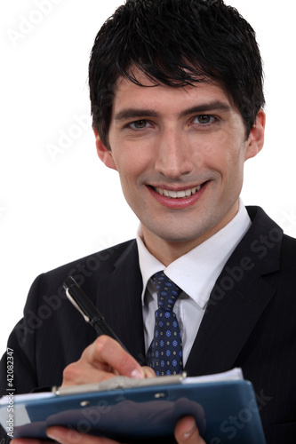 Smiling executive with a clipboard