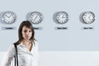 Businesswoman In Front Of World Time Zone Clocks